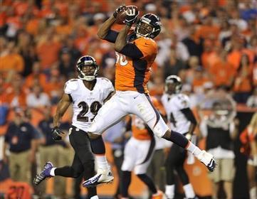 Manning Throws Seven TDs, Dismantles Ravens in Season Opener