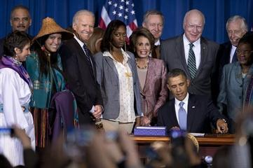 Obama Signs Expanded Violence Against Women Act
