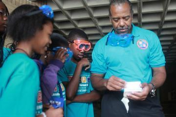 Middle-School Students Work With Black Astronaut at Science Camp