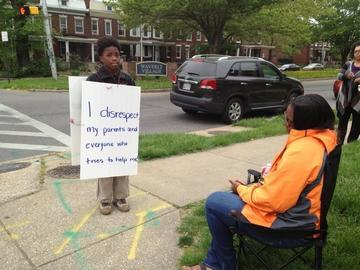 Loch Raven Mother Forces Son to Wear Sign for Disobedience