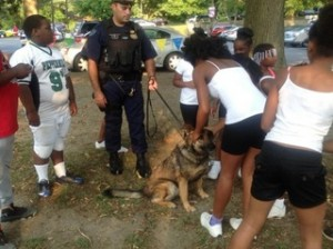 Young attendees at a National Night Out event in Landover pet a K9