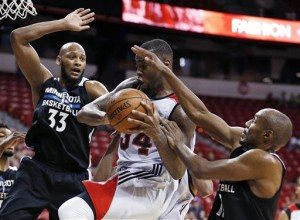 Portland Trail Blazers' Arnett Moultrie goes up for a shot against Minnesota Timberwolves' Adreian Payne, left, and Minnesota Timberwolves' C.J. Williams, right, during the second half of an NBA summer league basketball game Wednesday, July 15, 2015, in Las Vegas. (AP Photo/John Locher)