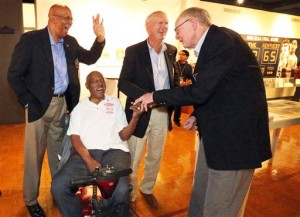 Members of the 1966 Texas Western College basketball championship team laugh together at a special exhibit on the team in the Union building on the UTEP campus in El Paso, Texas, Thursday, Feb. 4, 2016. They are from left: Nevil Shed, Willie Cager, Dick Myers and Louis Baudoin. Team members are in town for the 50th anniversary of the historic event. The game between Texas Western College and Kentucky was played on March 19, 1966. (Rudy Gutierrez/The El Paso Times via AP)