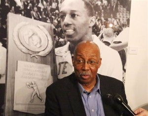 Nevil Shed, a member of the 1966 Texas Western College basketball NCAA championship team speaks of his recollections about the team's title game an an exhibit about the team on the UTEP campus Thursday, Feb. 4, 2016. The historic photo behind him is of teammate Orsten Artis. (Rudy Gutierrez/The El Paso Times via AP) EL DIARIO OUT; JUAREZ MEXICO OUT; MANDATORY CREDIT  IF USE ON LAM OR LAT AND EL DIARIO DE EL PASO OUT