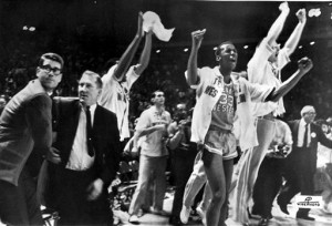 In this March 19, 1966 file photo, Texas Western College head basketball coach Don Haskins, second from left, and players celebrate after winning the 1966 NCAA basketball championship in College Park, Md. Players from Texas Western's 1966 NCAA championship team gather to open a weekend celebrating the 50th anniversary of the historic victory. With the first all-black starting lineup in a title game, the Miners beat all-white Kentucky in what is considered the most important game in college basketball history.  (AP Photo/File)