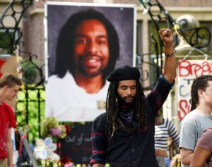 Tyler Clark Edwards of St. Paul raises his fist in the air in front of a large photo of Philando Castile, as protesters encamped in front of the Governor's residence in St. Paul, Minn. pack up their belongings Tuesday, July 26, 2016. Police have arrested an unknown number of protesters in front of the governor's mansion on St. Paul's Summit Avenue. Demonstrators have been camping outside the governor's residence since early July 7, a day after the shooting of Philando Castile, who was killed by a St. Anthony police officer during a traffic stop. (Scott Takushi/Pioneer Press via AP)