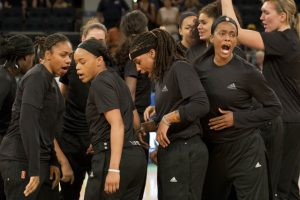 "Members of the New York Liberty basketball team shout after a team huddle prior to a game against the Atlanta Dream, Wednesday, July 13, 2016 in New York. Between the Black Lives Matter movement, the Orlando shooting and the LGBT community, more WNBA players have been taking active roles in expressing their views on social issues. In the midst of ""Camp Day"" at the New York Liberty's mid-morning game Wednesday, Liberty players stood in solidarity as they donned all-black warmups in support of the Black Lives Matter movement. (AP Photo/Mark Lennihan)"