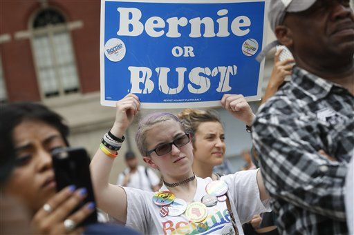 "A supporter of Sen. Bernie Sanders, I-Vt., holds a ""Bernie or BUST"" sign at a rally in Philadelphia, Thursday, July 28, 2016, during the final day of the Democratic National Convention. (AP Photo/John Minchillo)"