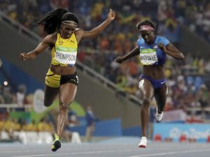 Elaine Thompson from Jamaica, left wins the gold medal in the women's 200-meter final ahead of third placed United States' Tori Bowie, right, during the athletics competitions of the 2016 Summer Olympics at the Olympic stadium in Rio de Janeiro, Brazil, Wednesday, Aug. 17, 2016. (AP Photo/David J. Phillip)