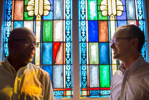 ADVANCE FOR USE MONDAY, AUG. 29, 2016 AND THEREAFTER-The Rev. James W. Goolsby, Jr., senior pastor of the First Baptist Church, left, and the Rev. Scott Dickison, senior pastor of First Baptist Church of Christ, right, pose for a photo at Dickison's church in Macon, Ga., on Monday, July 11, 2016. There are two First Baptist Churches in Macon _ one black and one white. Two years ago, Dickison and Goolsby met to try to find a way the congregations, neighbors for so long, could become friends. They'd try to bridge the stubborn divide of race. (AP Photo/Branden Camp)