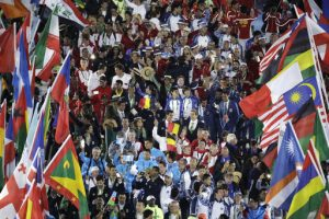 Athletes surrounded by flags march into the closing ceremony in the Maracana stadium at the 2016 Summer Olympics in Rio de Janeiro, Brazil, Sunday, Aug. 21, 2016. (AP Photo/Charlie Riedel)