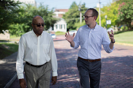 ADVANCE FOR USE MONDAY, AUG. 29, 2016 AND THEREAFTER-The Rev. James W. Goolsby, Jr., pastor of the First Baptist Church, left, and the Rev. Scott Dickison, pastor of the First Baptist Church of Christ, walk together in Macon, Ga., on Monday, July 11, 2016. In September 2016, they plan to lead joint discussions with their churches' members on racism in the history of the U.S., and also in the history of their congregations. (AP Photo/Branden Camp)