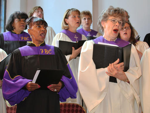 ADVANCE FOR USE MONDAY, AUG. 29, 2016 AND THEREAFTER-In this Sunday, May 24, 2015 photo provided by Sheryle Burger, members of Macon, Ga.'s two First Baptist Church congregations sing together in a choir during a Pentecost Sunday service held in the Rev. James Goolsby's church. There are two First Baptist Churches in Macon _ one black and one white. Two years ago, Goolsby and the Rev. Scott Dickison met to try to find a way the congregations, neighbors for so long, could become friends. They'd try to bridge the stubborn divide of race. (Sheryle Burger via AP)
