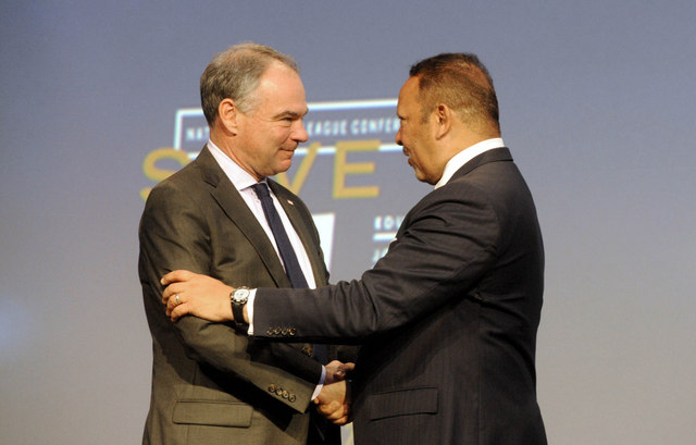 National Urban League President Marc H. Morial, right, greets Democratic Vice Presidential candidate, Sen. Tim Kaine, D-Va.  before a speech at the National Urban League, Thursday, Aug.4, 2016 in Baltimore.  (Caitlin Faw/The Baltimore Sun via AP)