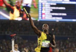 Jamaica's Usain Bolt celebrates winning the gold medal in the men's 4x100-meter relay final during the athletics competitions of the 2016 Summer Olympics at the Olympic stadium in Rio de Janeiro, Brazil, Friday, Aug. 19, 2016. (AP Photo/David J. Phillip)