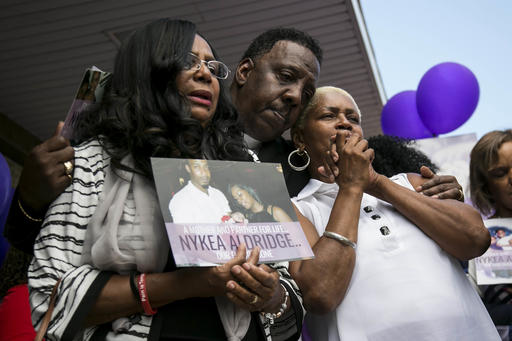 Family members and supporters hug Diann Aldridge during a vigil for her daughter Nykea Aldridge at the Willie Mae Morris Empowerment Center, Sunday afternoon, Aug. 28, 2016, in Chicago. Aldridge, a 32-year-old mother of four, and the cousin of NBA star Dwyane Wade, was pushing her baby in a stroller near a school where she'd planned to register her children when she was shot in the head and arm. She wasn't the intended target, Cmdr. Brendan Deenihan said at a news conference Sunday, but rather a driver who had just dropped off passengers in the neighborhood. (Ashlee Rezin/Chicago Sun-Times via AP)