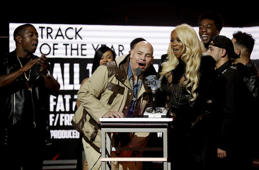 """Fat Joe, left, and Remy Ma, accept the Track of the Year award for """"All the Way Up"""" at the BET Hip-Hop Awards in Atlanta, Saturday, Sept. 17, 2016. (AP Photo/David Goldman)"""