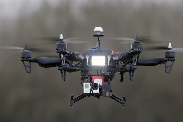 """French company Malou Tech's """"Army"""" speed drone mounted with a Go pro Hero3 during a demonstration flight in La Queue-en-Brie, east of Paris, France, Monday, Feb. 9, 2015. For months, France has faced dozens of drone overflights over sensitive sites — mostly nuclear facilities, a worrisome development in a country that gets the highest percentage of its energy in the world from atomic power. France wants to monitor and detect intruding drones and their remote-control pilots; analyze and track their flight paths; and ultimately neutralize the drones — either temporarily or permanently — with the least collateral damage possible. (AP Photo/Francois Mori)"""