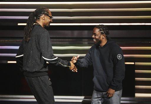 "Snoop Dogg, left, is greeted by Kendrick Lamar, right, as Lamar presents him with the ""I am Hip Hop"" award at the BET Hip Hop Awards in Atlanta, Saturday, Sept. 17, 2016. (AP Photo/David Goldman)"