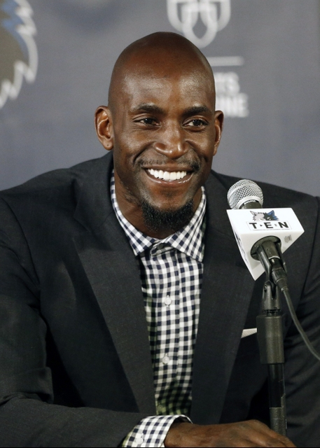 FILE- In this Feb. 24, 2015, file photo, Minnesota Timberwolves star Kevin Garnett speaks during an NBA basketball news conference in Minneapolis. The 15-time All-Star has a multiyear agreement with Turner Sports to join the network's wildly popular NBA coverage team. Turner says Garnett will serve as a contributor to the coverage, appearing weekly throughout the season from a stand-alone set to provide insight and commentary on the league. Garnett retired this month after 21 seasons in the league. (AP Photo/Jim Mone, File)