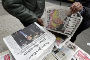 Headlines announce the victory of President-elect Donald Trump at a news vendor's table on New York's Upper West Side, Wednesday, Nov. 9, 2016. (AP Photo/Richard Drew)
