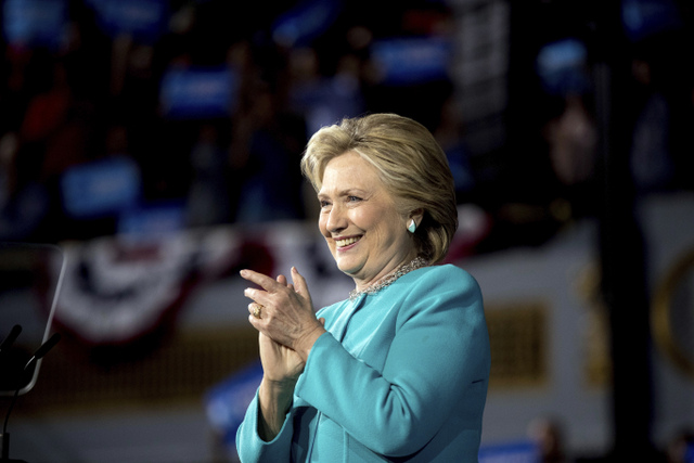 Democratic presidential candidate Hillary Clinton applauds after speaking at a rally at the Cleveland Public Auditorium in Cleveland, Sunday, Nov. 6, 2016. (AP Photo/Andrew Harnik)
