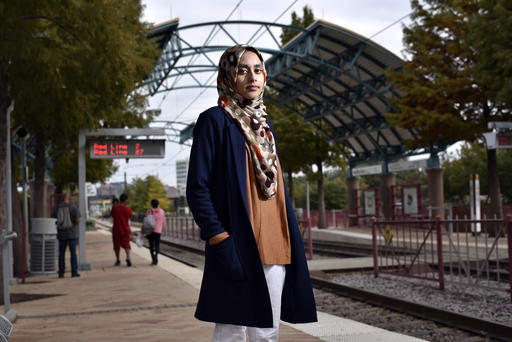 Aysha Khan, 21, a Muslim woman who rides the DART from Arapaho Center Station to the University of Texas at Dallas, is photographed wearing her hijab, or head covering, at the station on Saturday, Nov. 12, 2016 in Richardson, Texas. Her parents have asked her to start driving to school after Donald Trump was elected. Frightened by the sweeping victory of a man who at one point called for a national database to track Muslims, young Muslim Americans across Texas described feeling alienated from the only country they've known as home. (Ben Torres/The Dallas Morning News via AP)