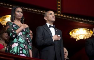 President Barack Obama and first lady Michelle Obama, put their hand over their heart as the national anthem is sang during the Kennedy Center Honors Gala at the Kennedy Center in Washington, Sunday, Dec. 4, 2016. (AP Photo/Manuel Balce Ceneta)