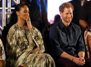 In this photo taken on Wednesday, Nov. 30, 2016, Britain's Prince Harry and Bajan singer Rihanna attend Golden anniversary celebrations at the Kensington Oval cricket ground, marking 50 years of the island's independence from England, in Bridgetown, Barbados. (Chris Radburn/PA via AP)