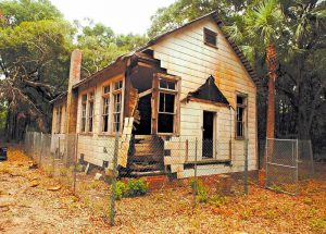 In this undated photo, a one-room schoolhouse built in the 1920s to teach black children on St. Simons Island, GA., is making a comeback from years of rot and neglect. Preservationists saved the Harrington School from scheduled demolition in 2010 and since then have spent about $300,000 to stabilize its deteriorating frame and leaky roof. Recently, the group Friends of the Harrington School announced a grant award that it hopes will bring in $50,000 needed to finish restoring the schoolhouse's interior. (Bobby Haven/The Brunswick News via AP)