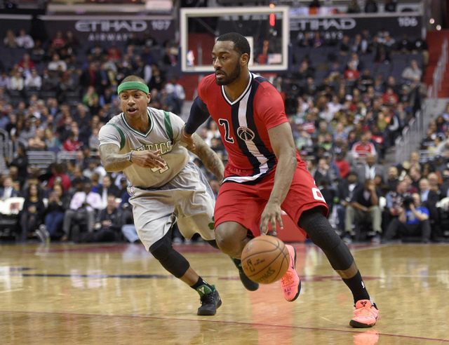Washington Wizards guard John Wall (2) drives to the basket past Boston Celtics guard Isaiah Thomas (4) during the first half of an NBA basketball game, Tuesday, Jan. 24, 2017, in Washington. (AP Photo/Nick Wass)