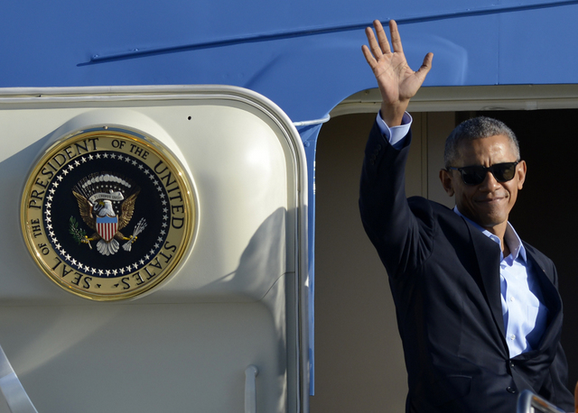 "FILE - In this Oct. 9, 2016 file photo, President Barack Obama, wearing sunglasses, waves while boarding Air Force One before leaving O'Hare International Airport in Chicago. From his campaign fist bump to his theatrical mic drop at the last White House correspondents' dinner, Barack Obama ruled as America's pop culture president. His two terms played out like a running chronicle of the trends of our times: slow-jamming the news with Jimmy Fallon, reading mean tweets with Jimmy Kimmel, filling out his NCAA basketball bracket on ESPN, cruising with Jerry Seinfeld on ""Comedians in Cars Getting Coffee."" (AP Photo/Paul Beaty, File)"