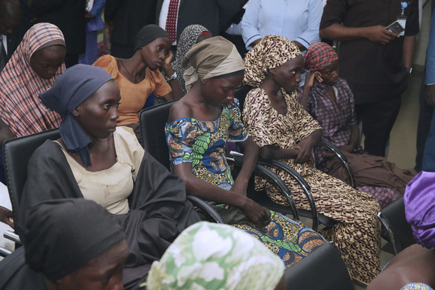 In this photo released by the Nigeria State House, freed Chibok school girls sit during a meeting with Nigeria Vice President ,Yemi Osinbajo, in Abuja,, Nigeria, Thursday, Oct. 13, 2016. Twenty-one of the Chibok schoolgirls kidnapped by Boko Haram more than two years ago were freed Thursday in a swap for detained leaders of the Islamic extremist group — the first release since nearly 300 girls were taken captive in a case that provoked international outrage. (Sunday Aghaeze/Nigeria State House via AP)