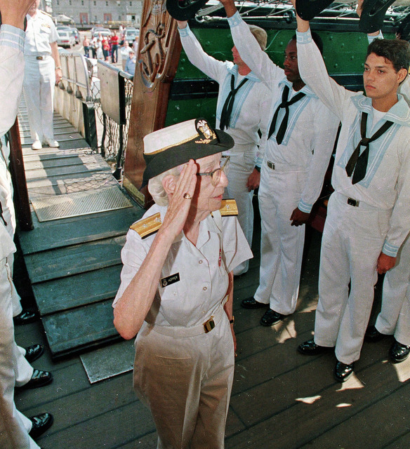 FILE - In this Aug. 14, 1986 file photo, Rear Admiral Grace Hopper is saluted by crew members aboard the USS Constitution, as she arrives for her retirement ceremony, in Boston, Mass. On Saturday, Feb. 11, 2017, Yale University said it is renaming Calhoun College after Hooper, a trailblazing computer scientist, a mathematician who earned Yale degrees in the 1930s, invented a pioneering computer programming language and became a Navy rear admiral. (AP Photo/Peter Southwick)