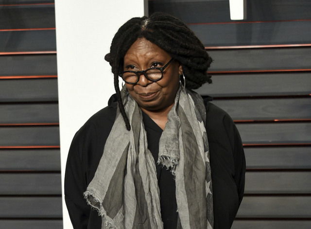 "FILE - This Feb. 28, 2016, file photo, shows Whoopi Goldberg at the Vanity Fair Oscar Party in Beverly Hills, Calif. The host of ABC's ""The View"" on Monday, March 13, 2017, condemned a story that circulated last week falsely claiming that she said Navy SEAL widow Carryn Owens appeared at President Donald Trump's speech before Congress for the ""attention."" (Photo by Evan Agostini/Invision/AP, File)"