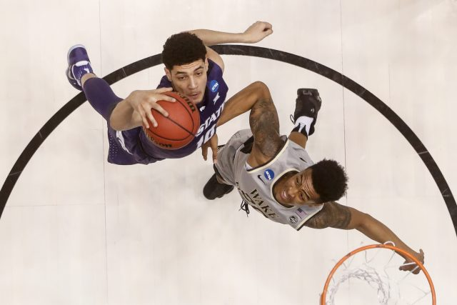 Kansas State's Isaiah Maurice, left, and Wake Forest's John Collins, right, battle for a rebound in the first half of a First Four game of the NCAA college basketball tournament, Tuesday, March 14, 2017, in Dayton, Ohio. (AP Photo/John Minchillo)