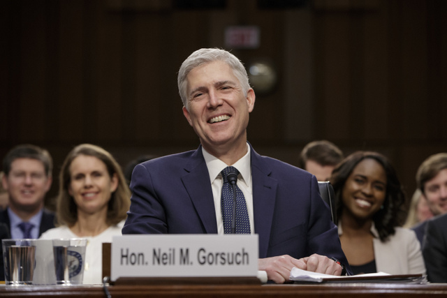 Supreme Court Justice nominee Neil Gorsuch laughs as he testifies on Capitol Hill in Washington, Wednesday, March 22, 2017, at his confirmation hearing before the Senate Judiciary Committee.  (AP Photo/J. Scott Applewhite)