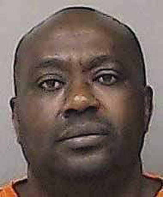This an undated photo provided by the Linn County Jail in Cedar Rapids, Iowa, shows Gervais Ngombwa. A federal judge is expected to sentence Ngombwa, a Rwandan man Thursday, March 2, 2017, for lying to gain citizenship in the U.S. after helping carry out deadly attacks during the country's 1994 genocide. (Linn County Jail via AP)